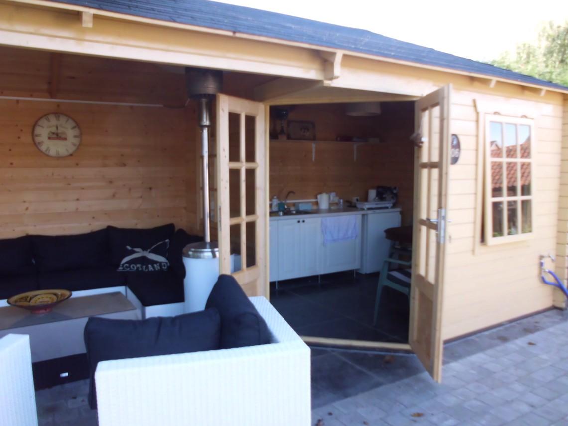 Blokhut-tuinhuis-carport volbracht dankzij LDC Tuinen BVBA